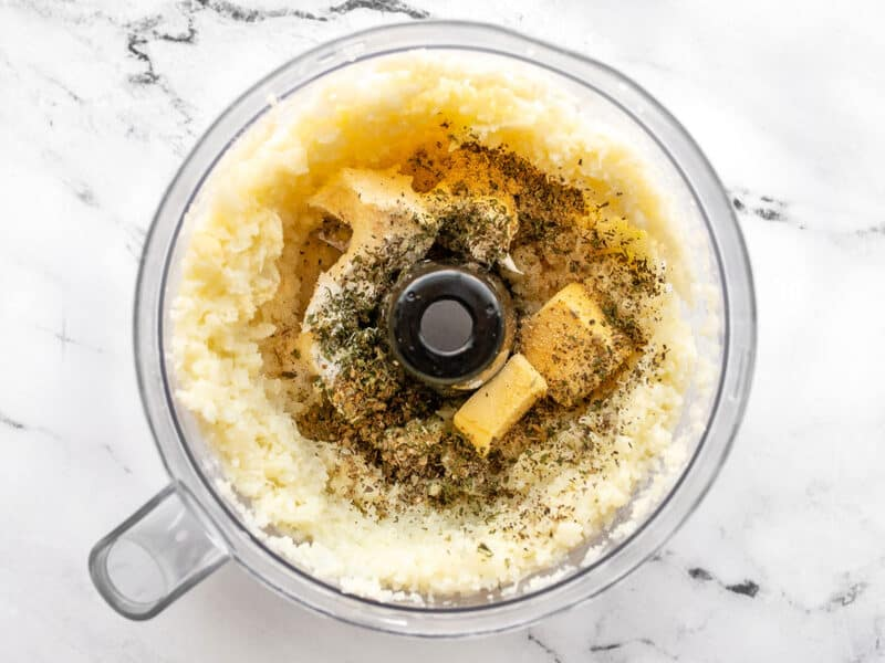 Seasoning added to food processor with the cauliflower