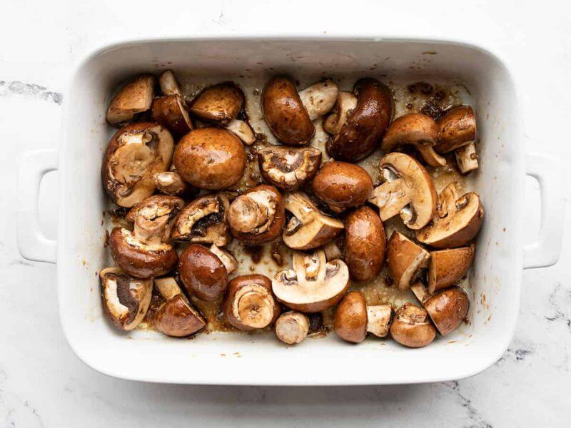 Seasoned mushrooms in the dish before roasting