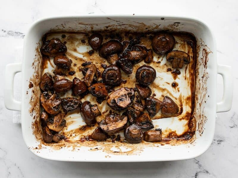Stirred roasted mushrooms in the dish
