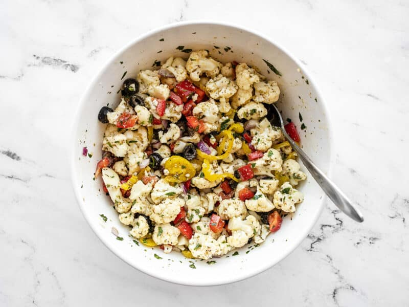 Finished marinated cauliflower salad in the bowl with a spoon