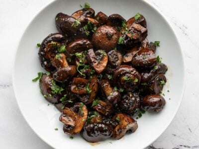 Overhead view of balsamic roasted mushrooms in a white bowl