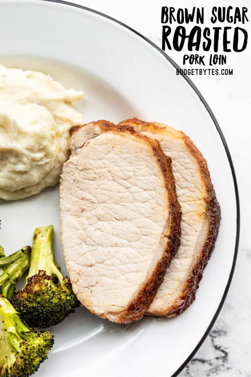 Brown Sugar Roasted Pork Loin slices on a plate with potatoes and broccoli