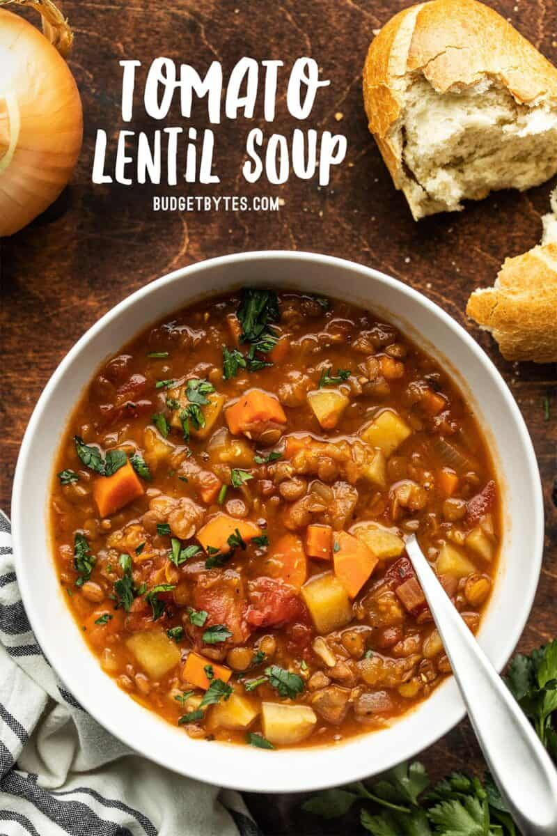 A bowl of tomato lentil soup with title text at the top
