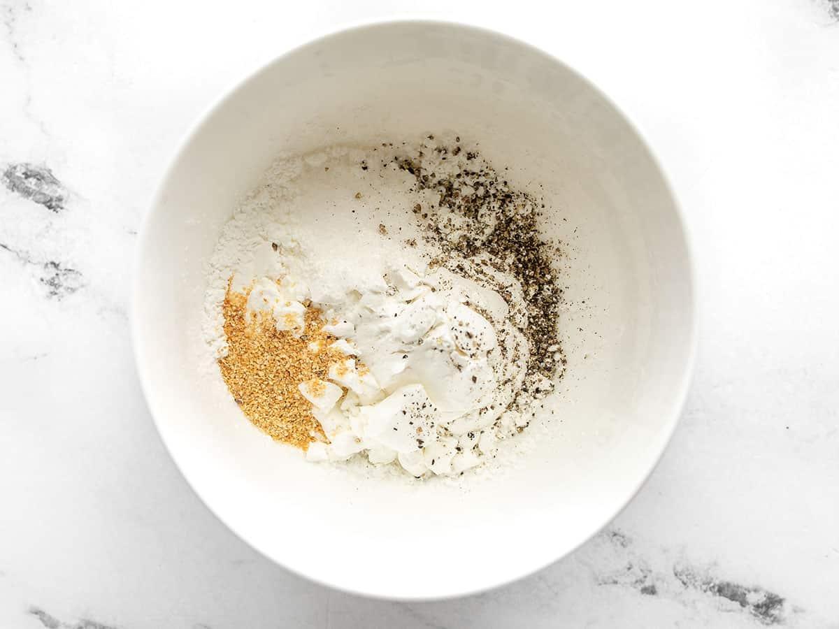 Cornstarch, salt, pepper, and garlic powder in a bowl
