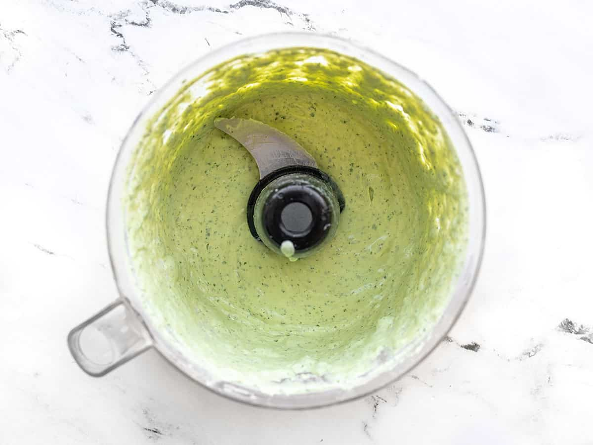 finished avocado dressing in the food processor
