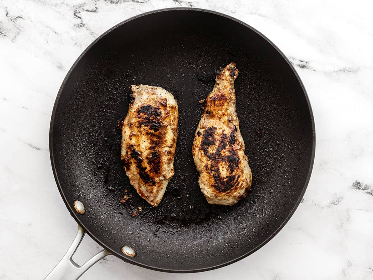 Cooked yogurt marinated chicken in the skillet