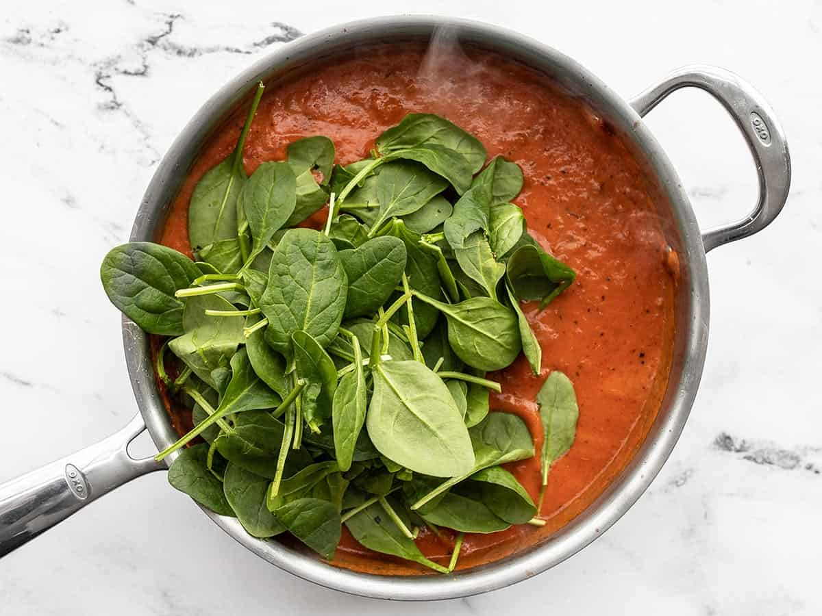 fresh spinach added to the sauce
