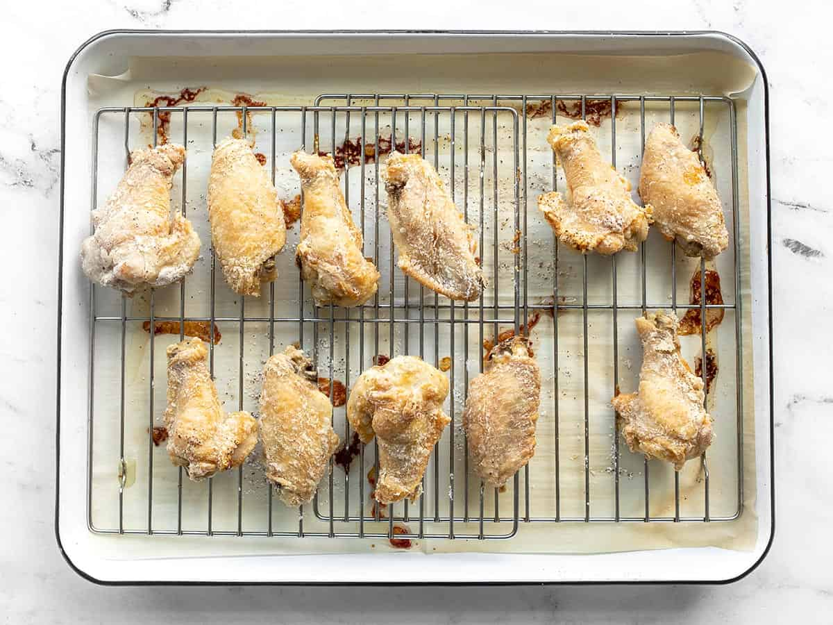 Baked chicken wings on the baking sheet