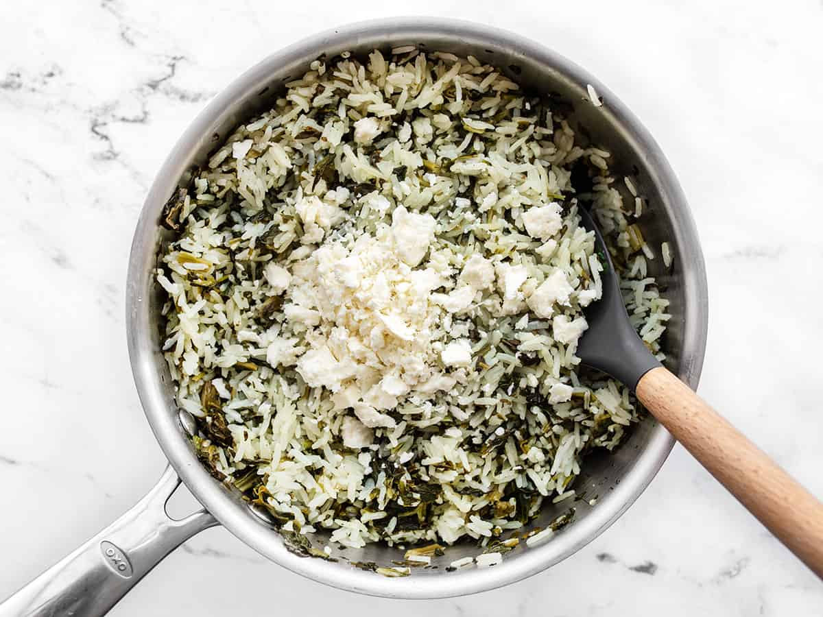 crumbled feta added to rice