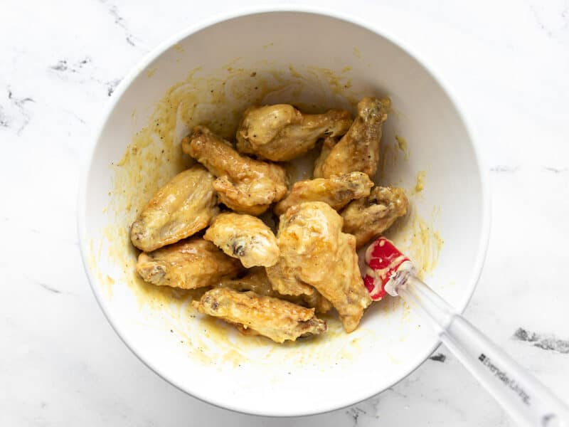 Finished honey mustard wings in a bowl