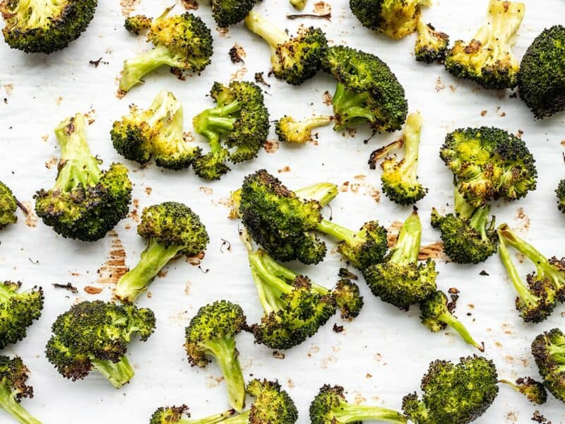 Oven roasted broccoli close up on the baking sheet
