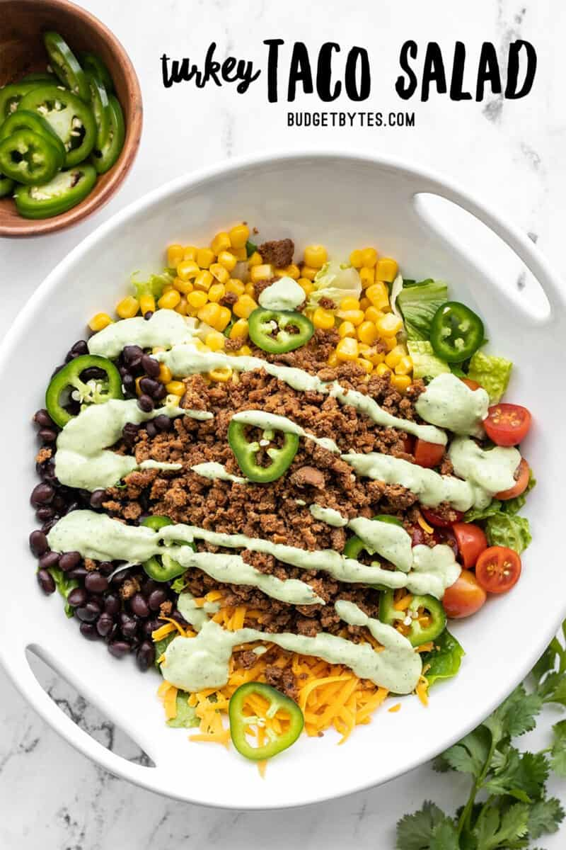 Turkey Taco Salad in a serving bowl, title text at the top