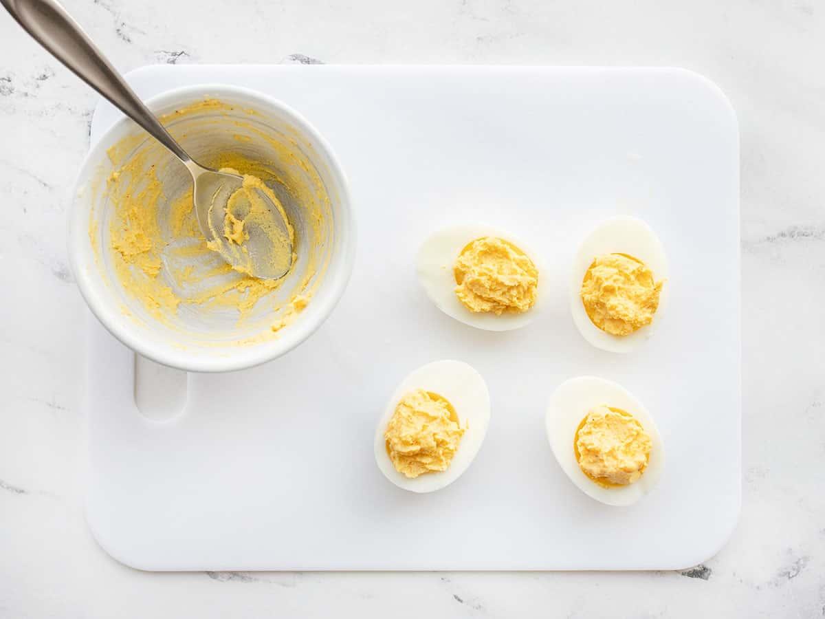 Mashed and seasoned yolk returned to the egg whites