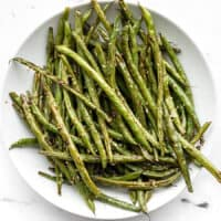 Sesame roasted green beans on a plate, viewed from above