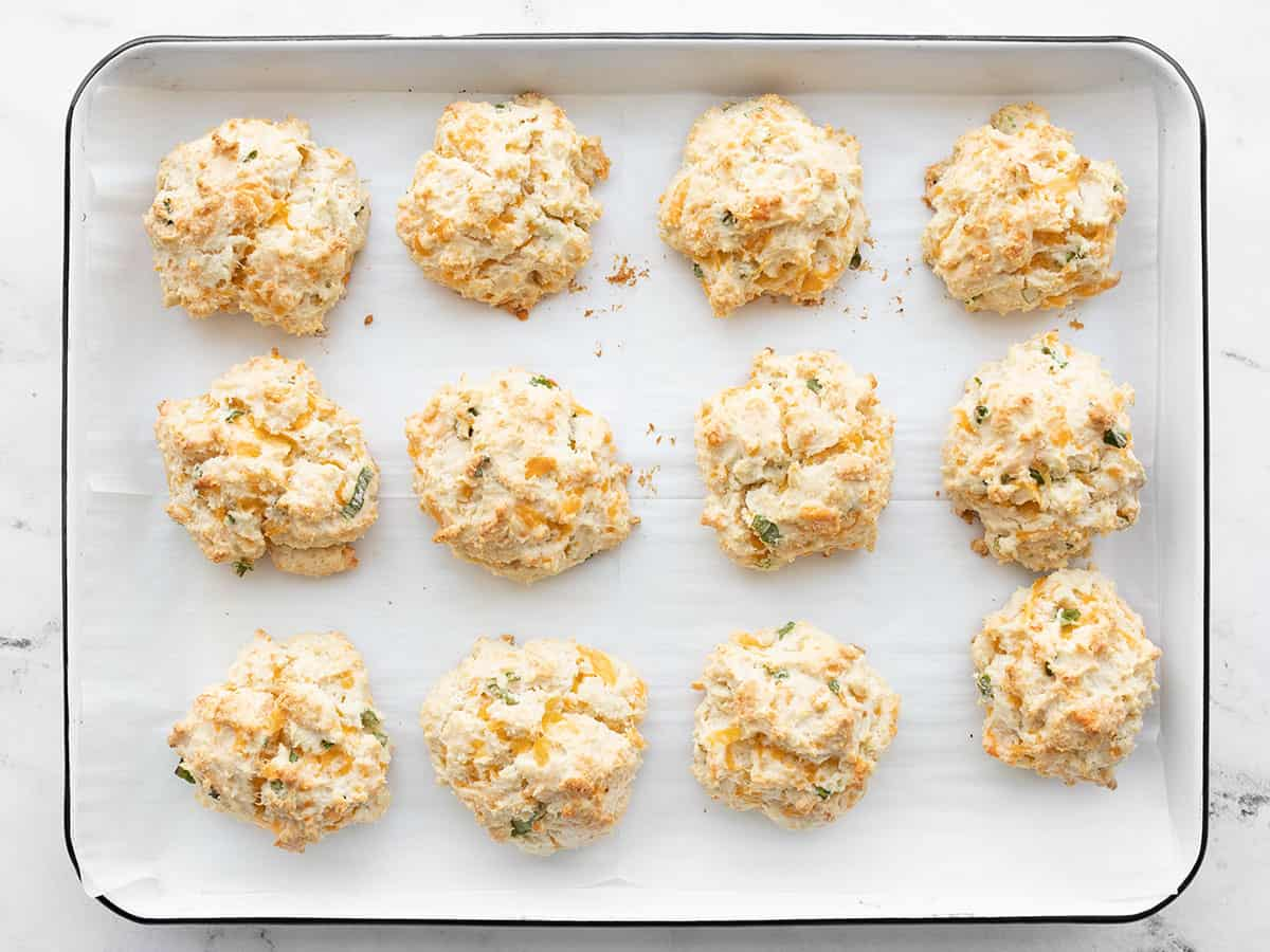 Baked cheddar drop biscuits on the baking sheet