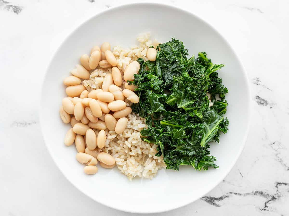 Power bowls base layer of rice, kale, and beans