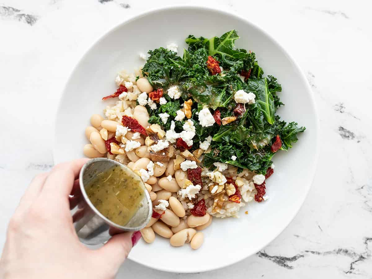 Sun dried tomatoes, walnuts, feta, and dressing added to the power bowl