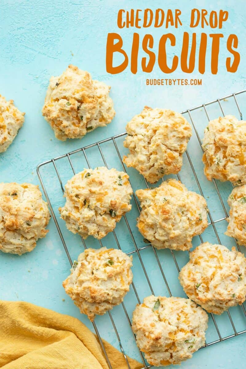 Cheddar drop biscuits on a cooling rack, title text at the top
