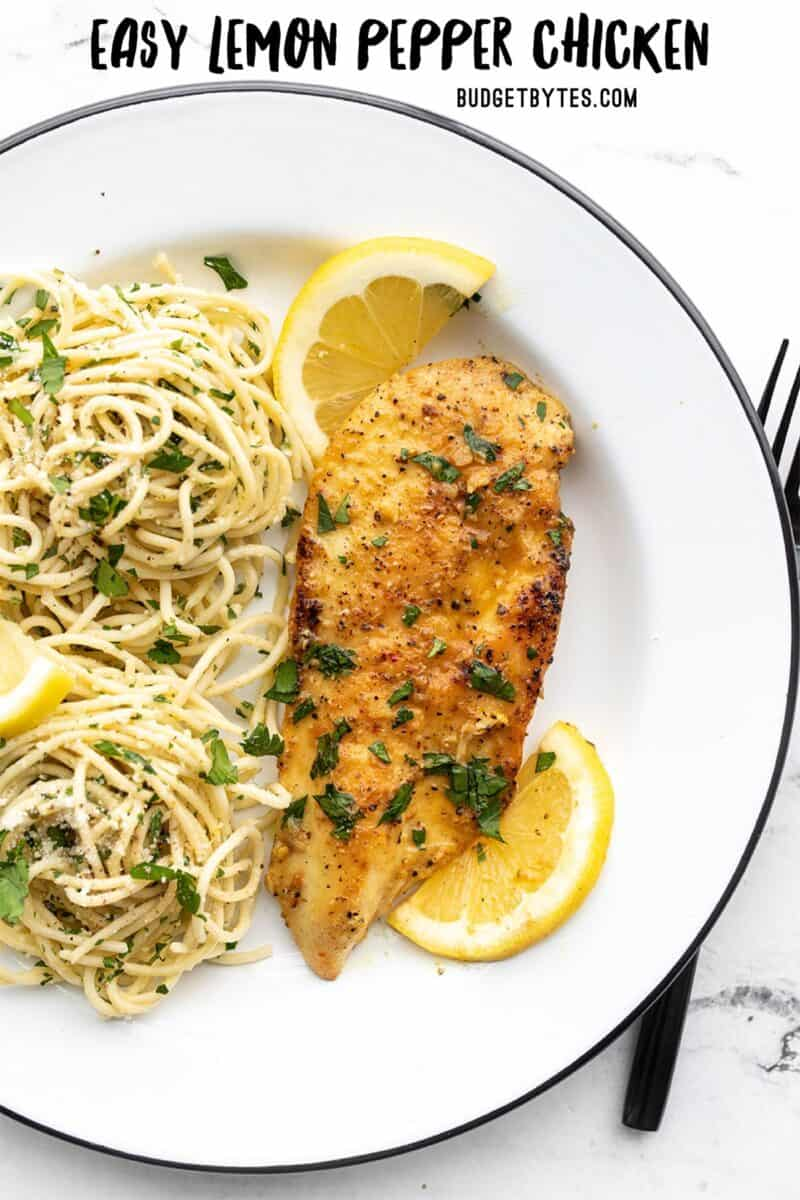 Lemon pepper chicken on a plate with pasta