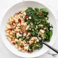 Overhead view of a Kale and White Bean Power Bowl with a fork in the side