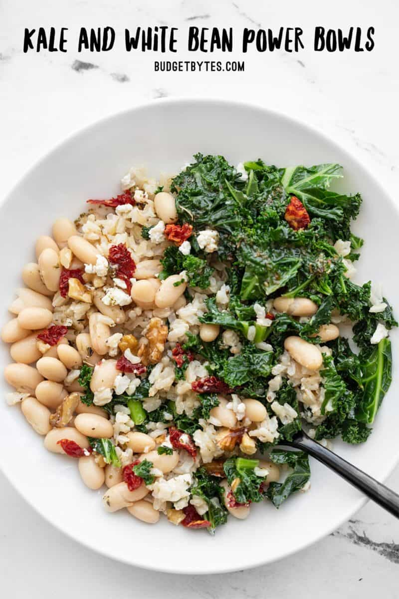 Overhead view of a Kale and White Bean Power Bowl, title text at the top