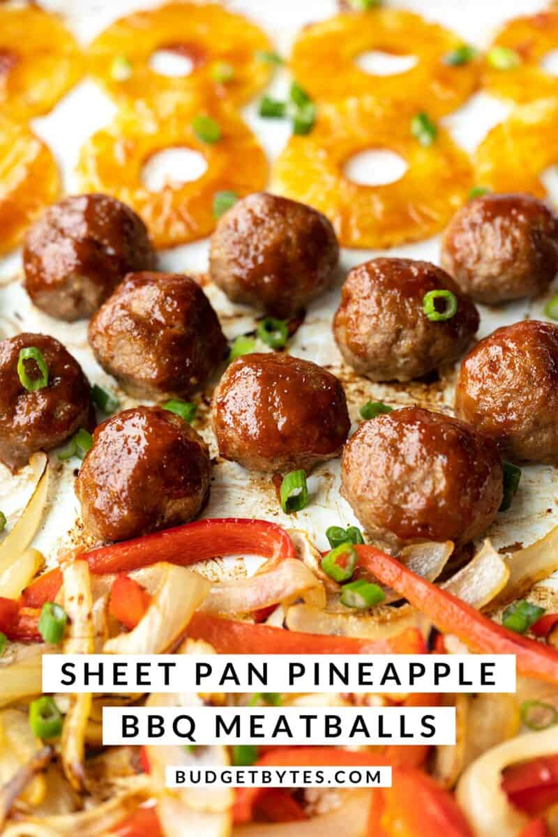 Front view of bbq meatballs, peppers, onions, and pineapple on a sheet pan. Title text at the bottom