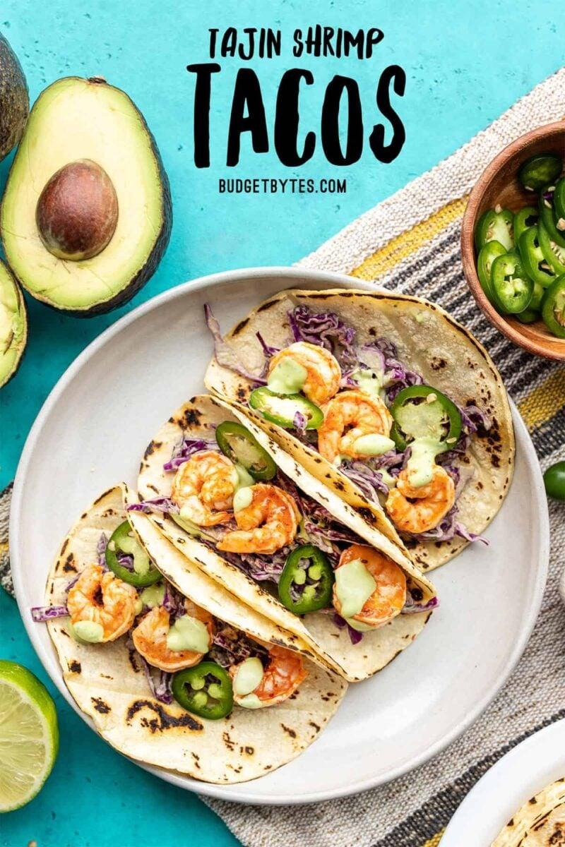Three Tajín Shrimp Tacos on a plate, title text at the top