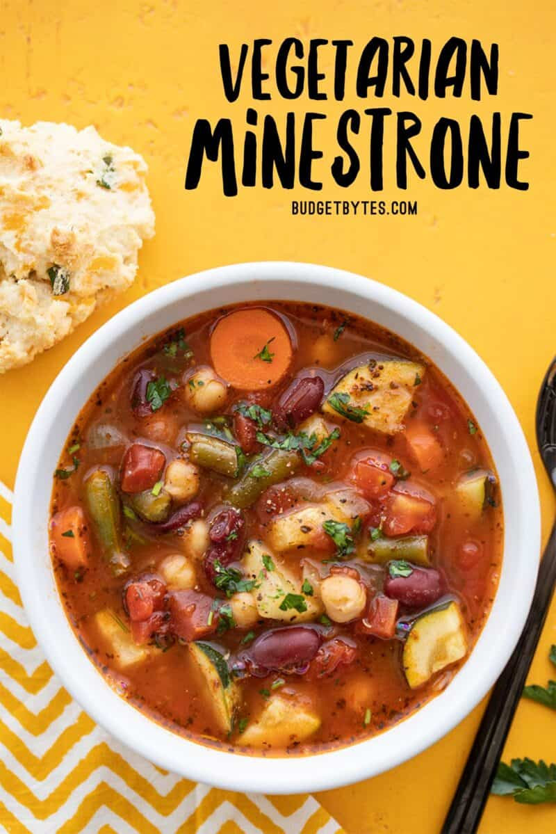 Overhead view of a bowl full of vegetarian minestrone, title text at the top