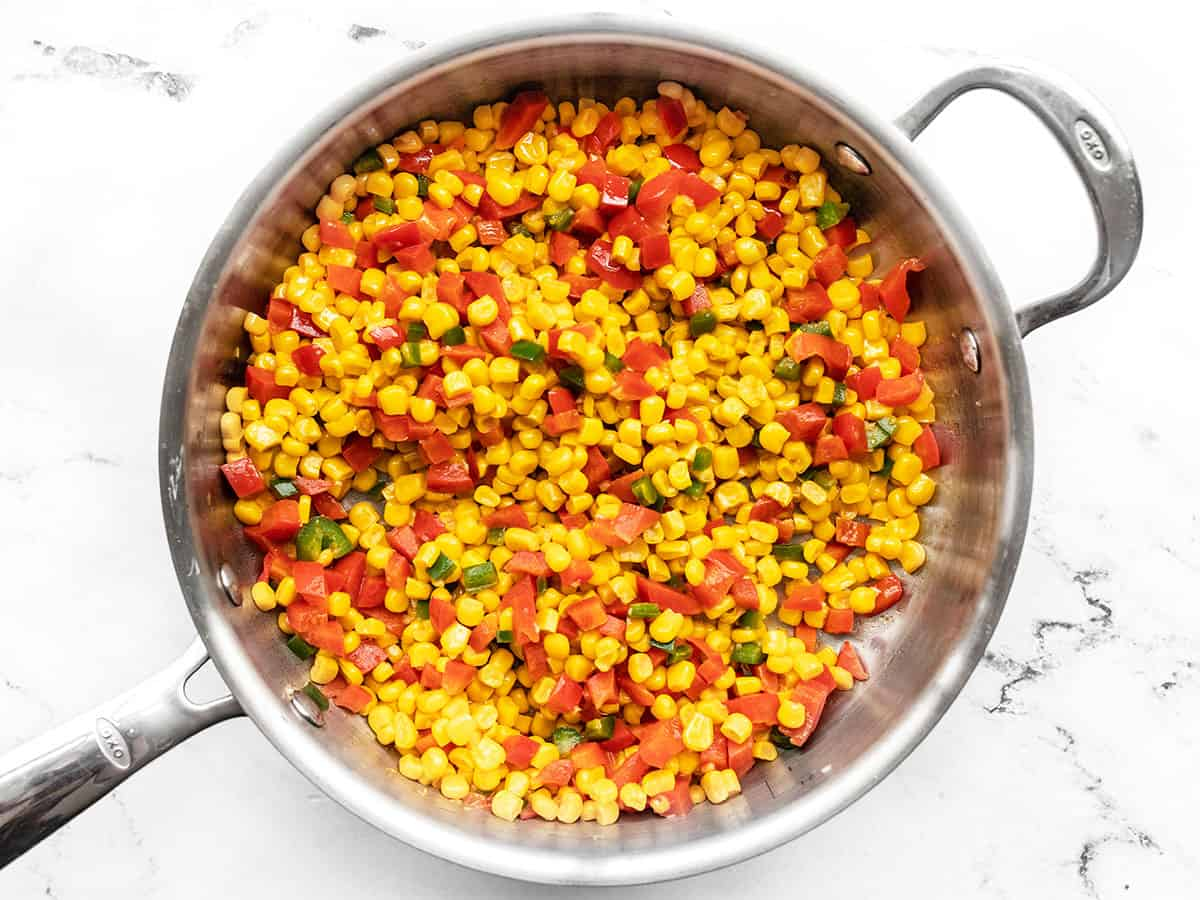 Frozen corn added to the skillet