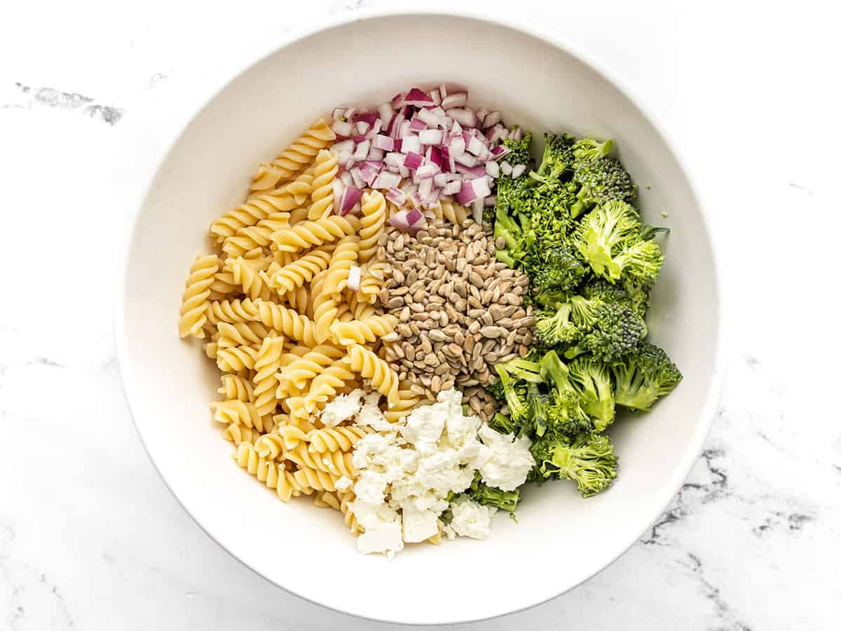 Broccoli pasta salad ingredients in a bowl