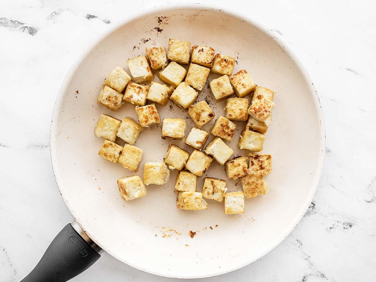 Crispy tofu in a skillet