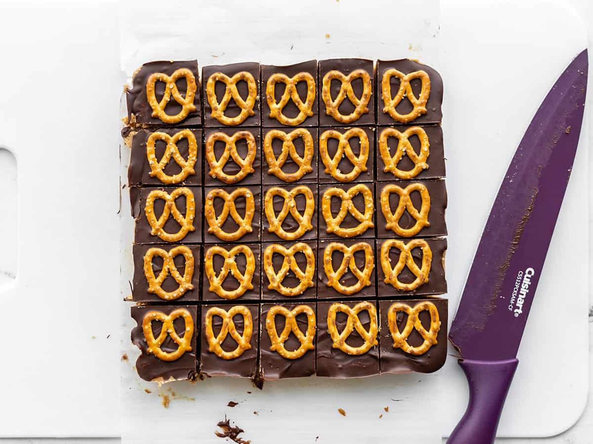 No Bake Pretzel Peanut Butter Bars being cut