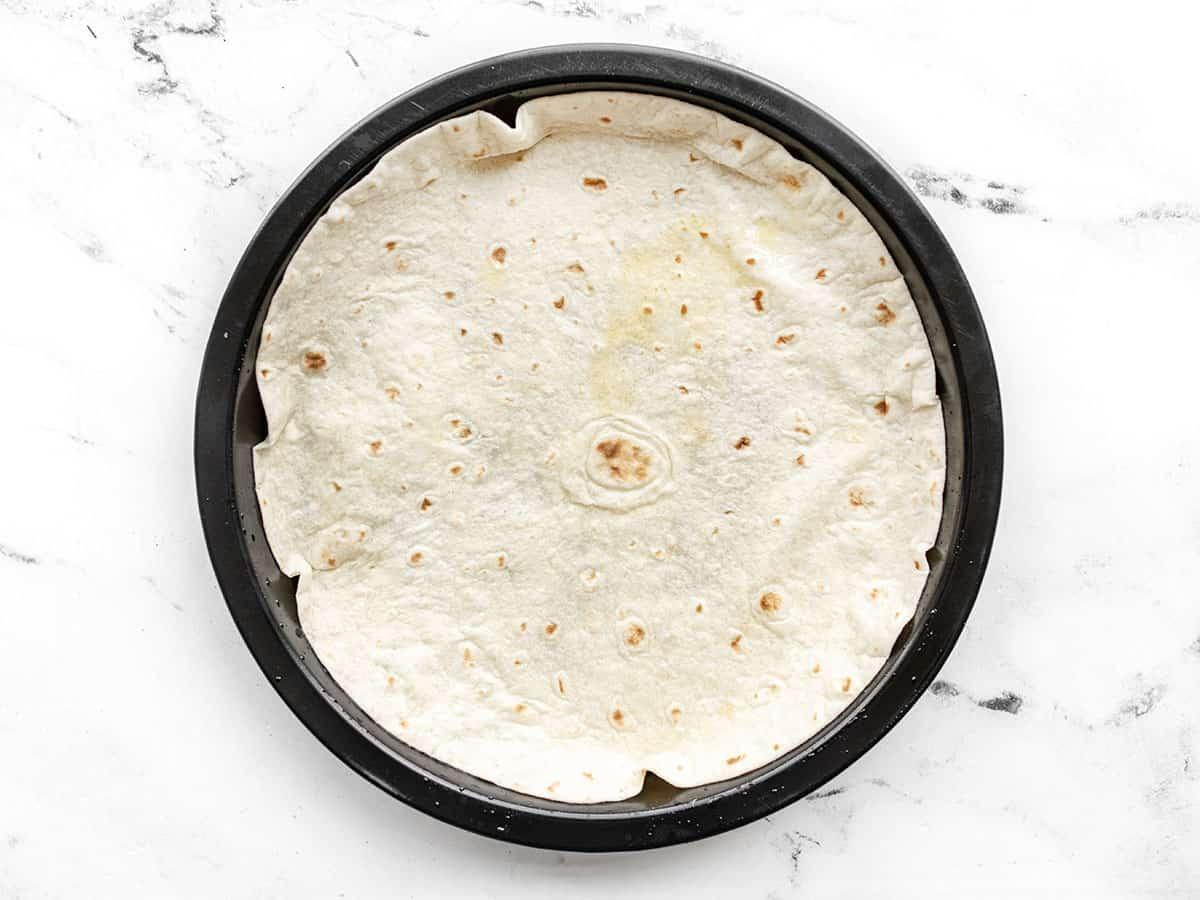 Tortilla pressed into baking dish