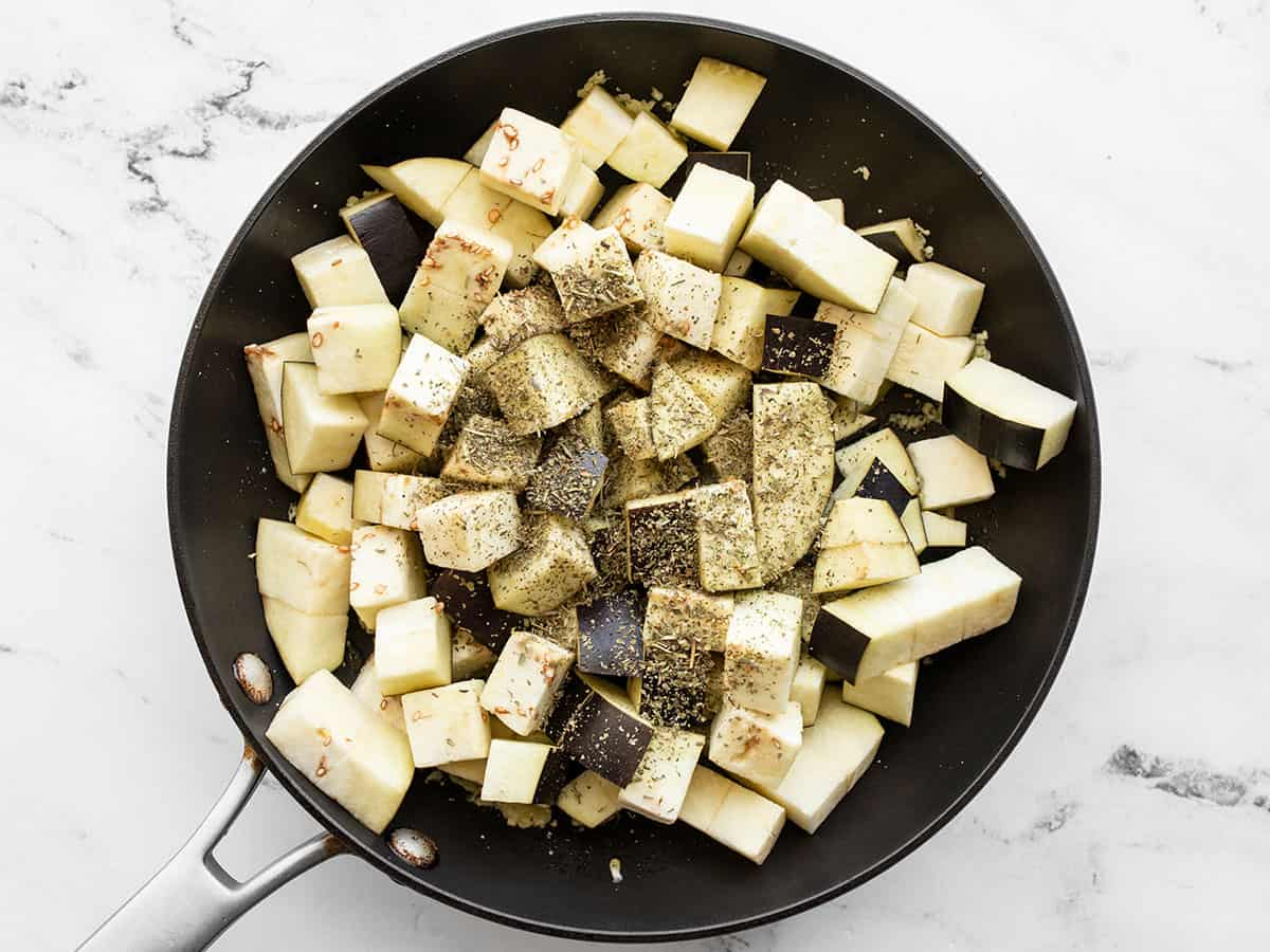 Cubed eggplant in the skillet with Italian seasoning