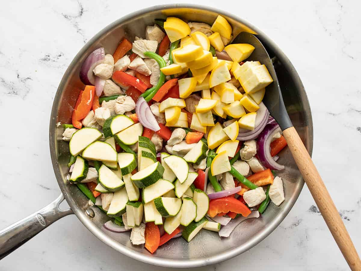 zucchini and yellow squash added to the skillet