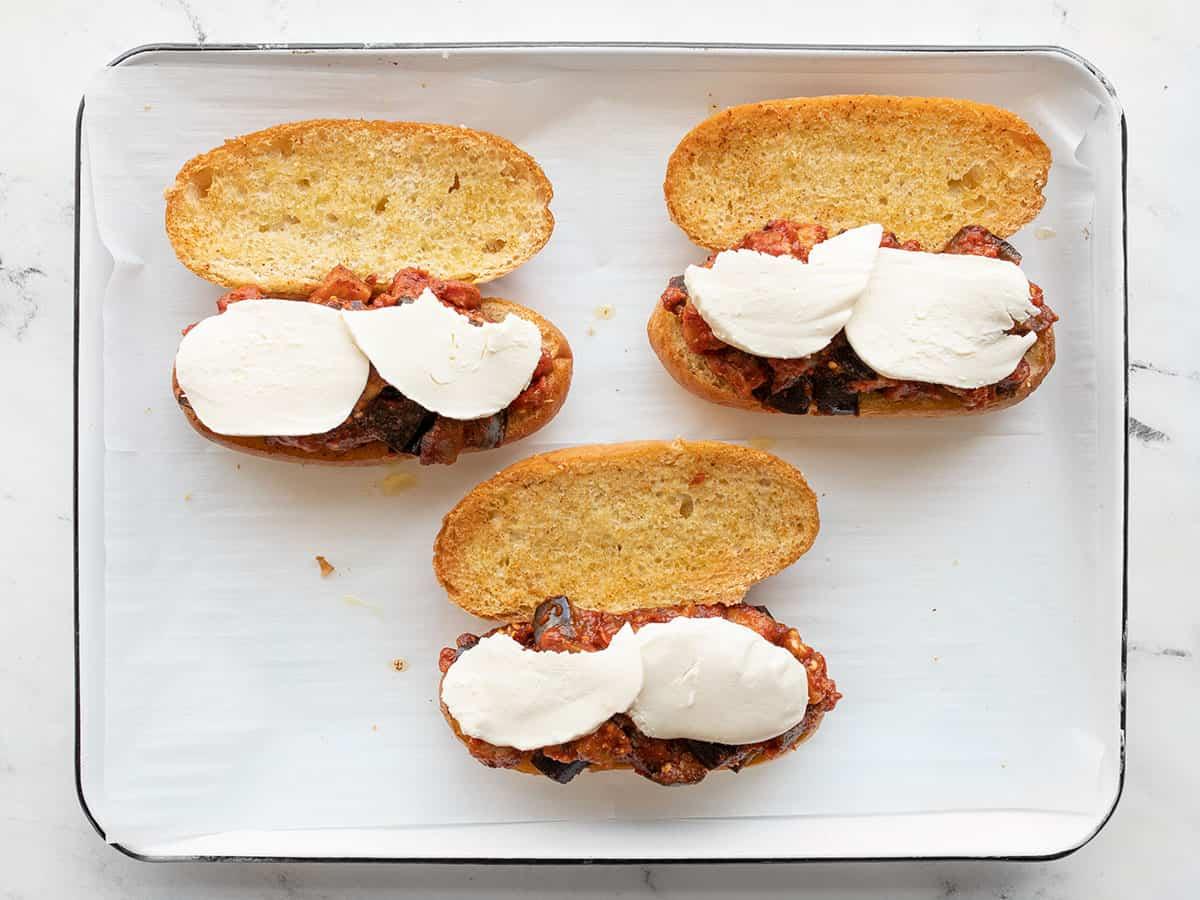 sandwiches topped with mozzarella