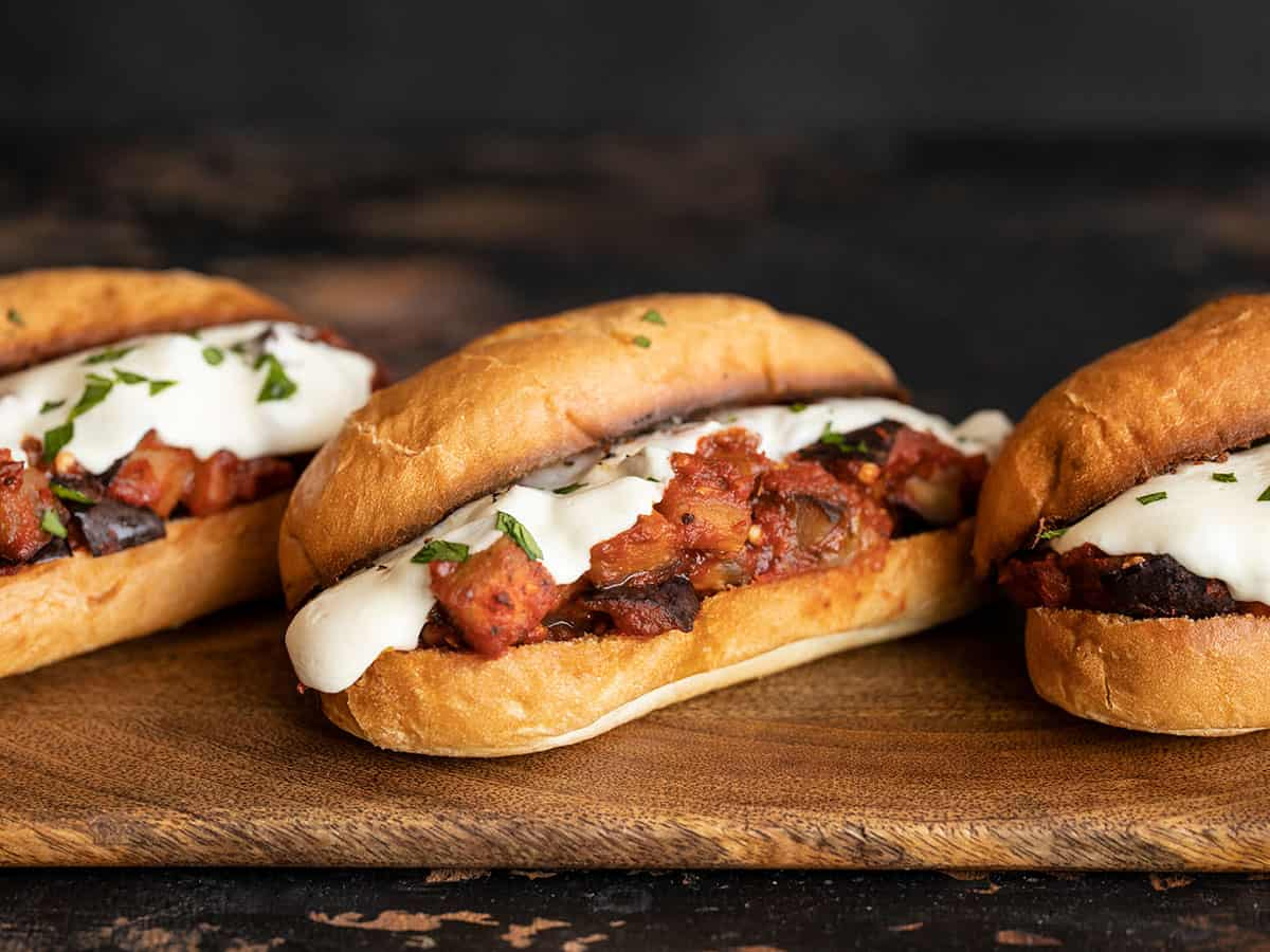 three eggplant mozzarella sandwiches in a line, angled away from the camera