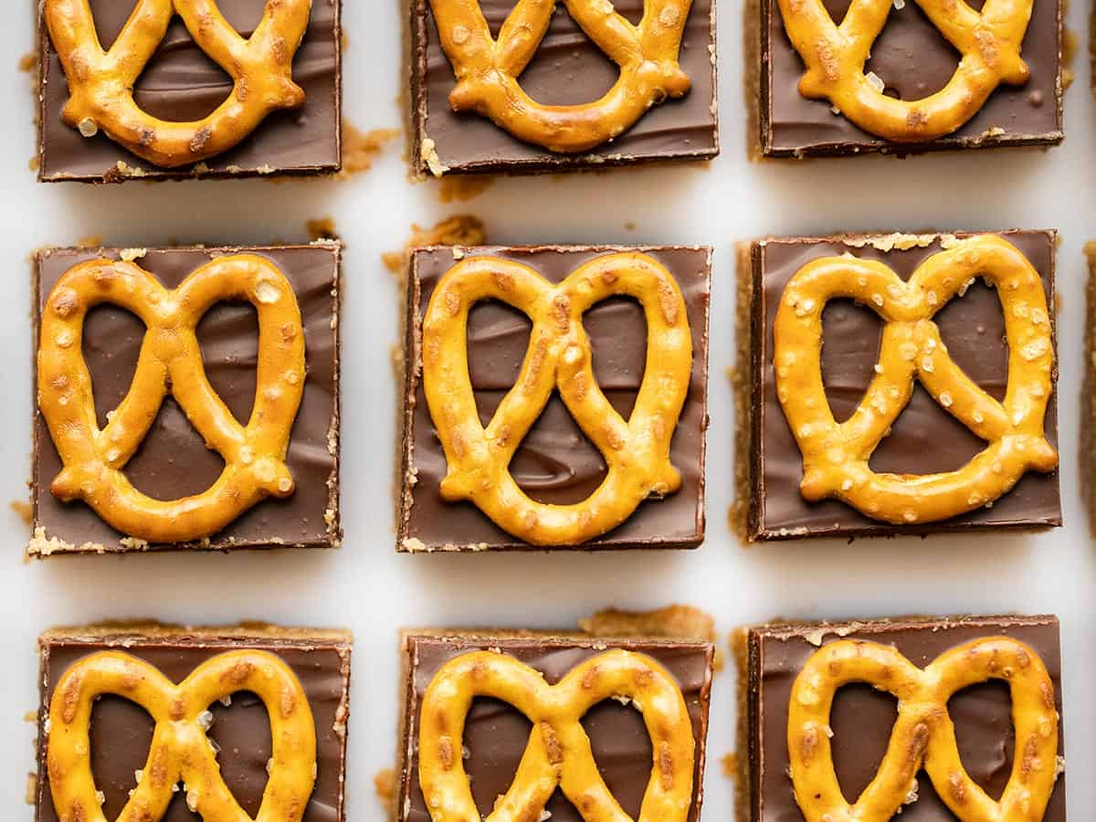 overhead view of no bake pretzel peanut butter bars lined up in a grid