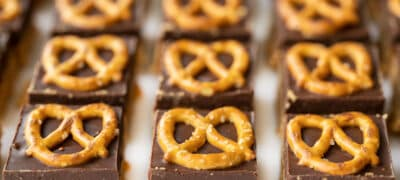 front view of no bake pretzel peanut butter bars lined up in a grid