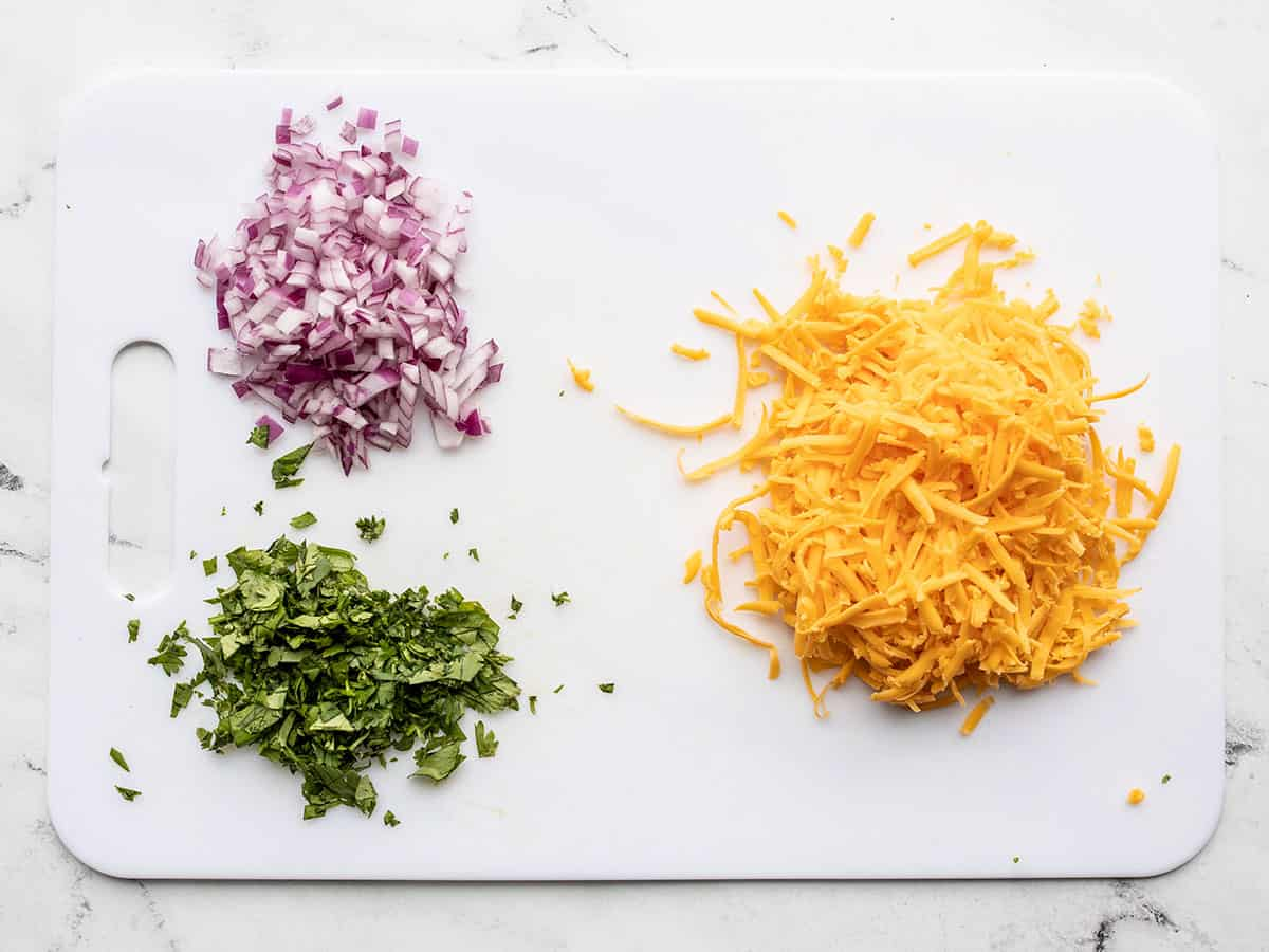 Prepared toppings: red onion, cilantro, and cheddar