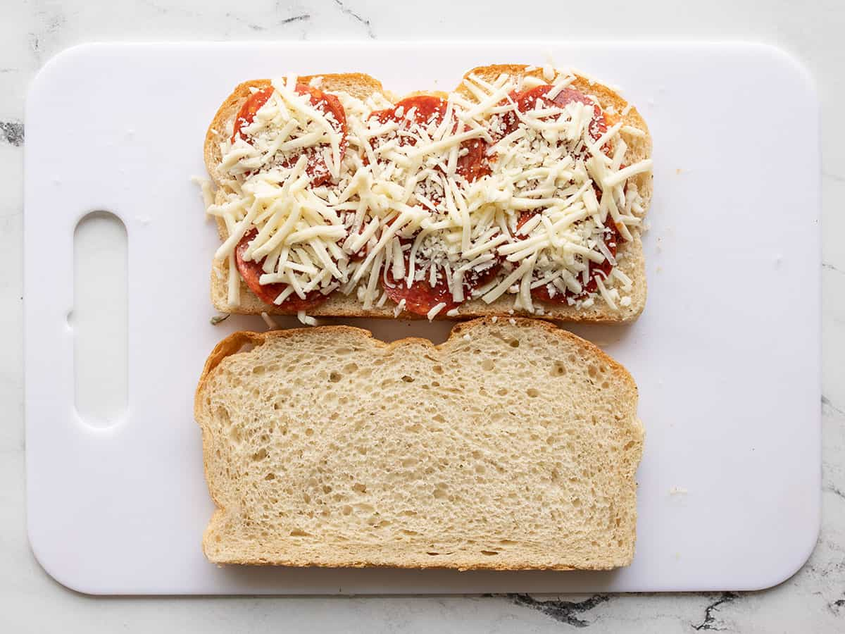 pepperoni and cheese added to the sandwich
