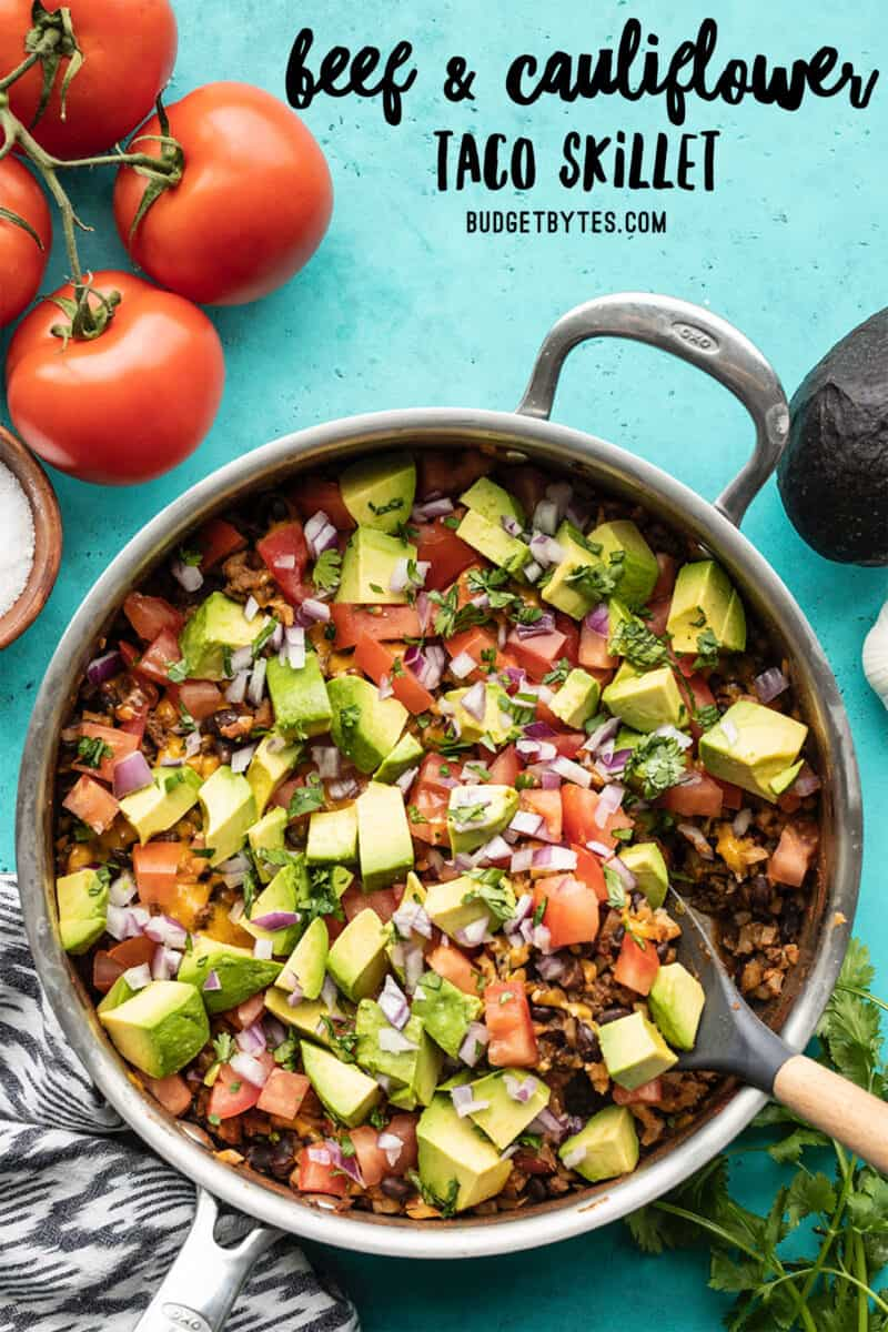 Overhead view of beef and cauliflower taco skillet, title text at the top