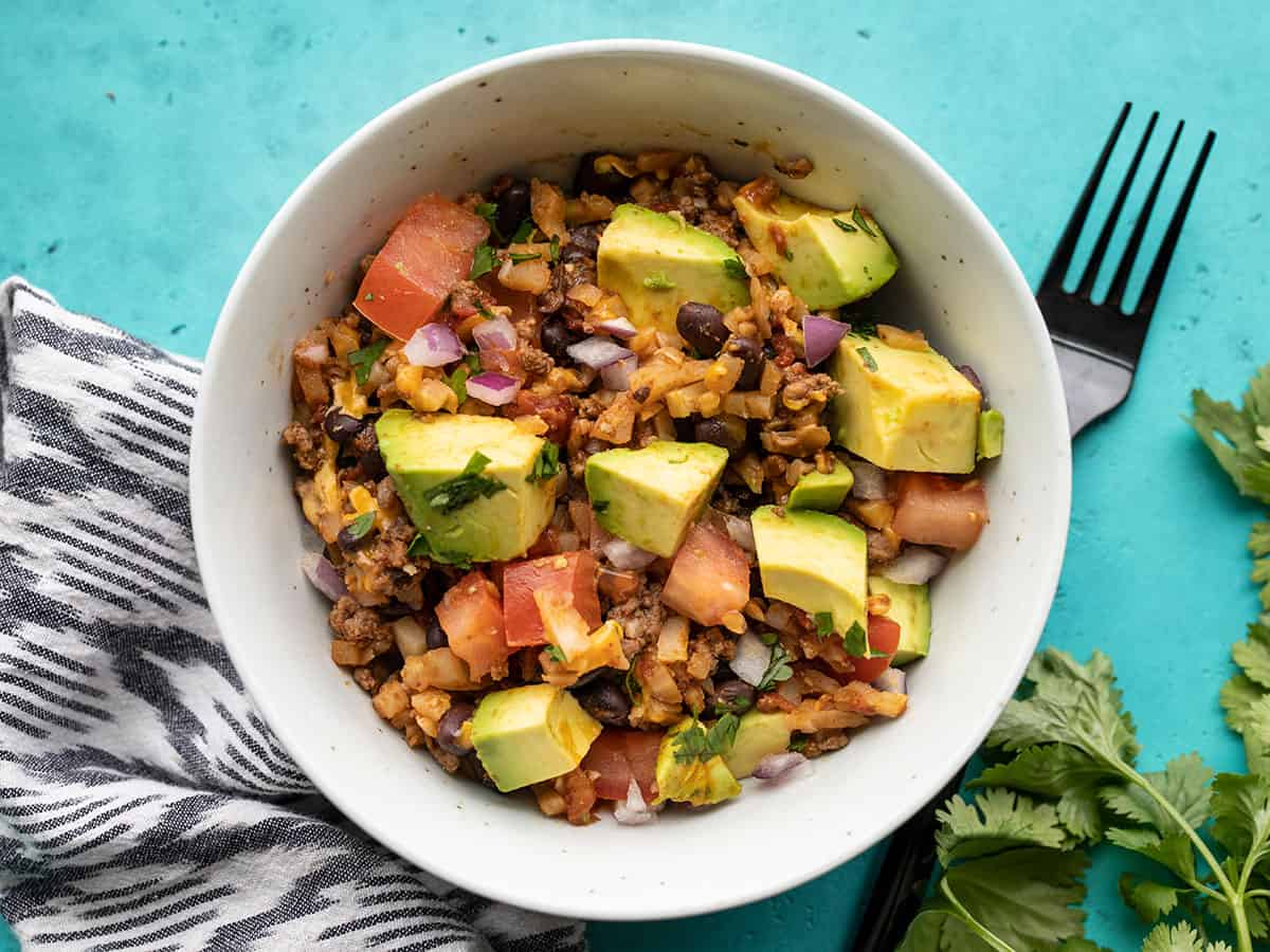 beef and cauliflower taco skillet in a bowl with a fork on the side