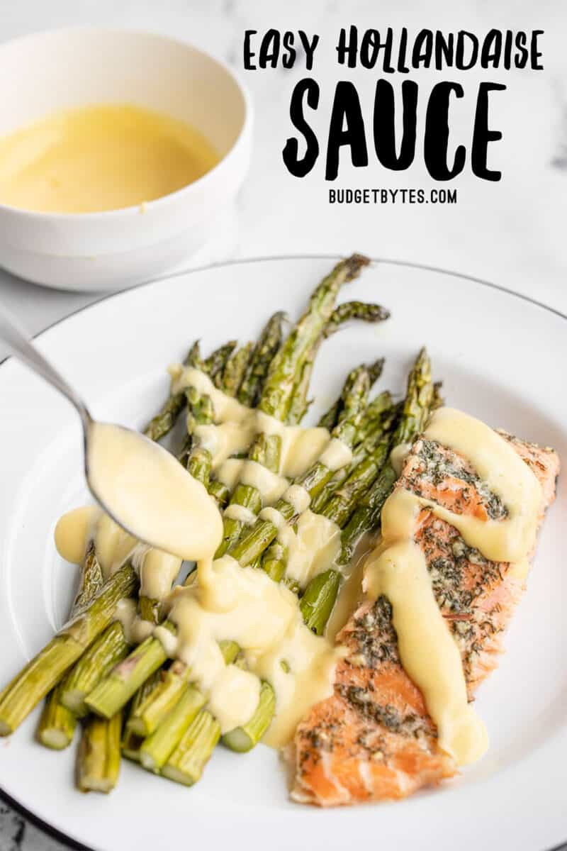 hollandaise sauce being drizzled over asparagus and salmon, title text at the top
