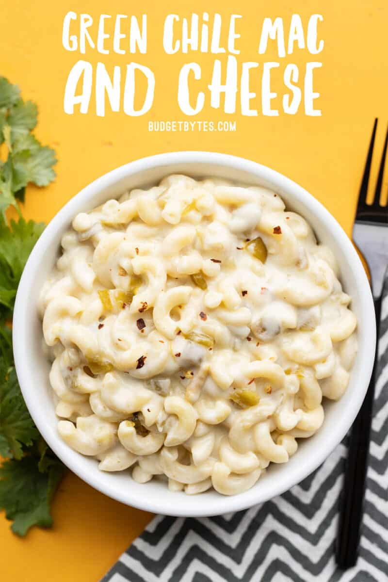 Green chile mac and cheese in a bowl with title text at the top