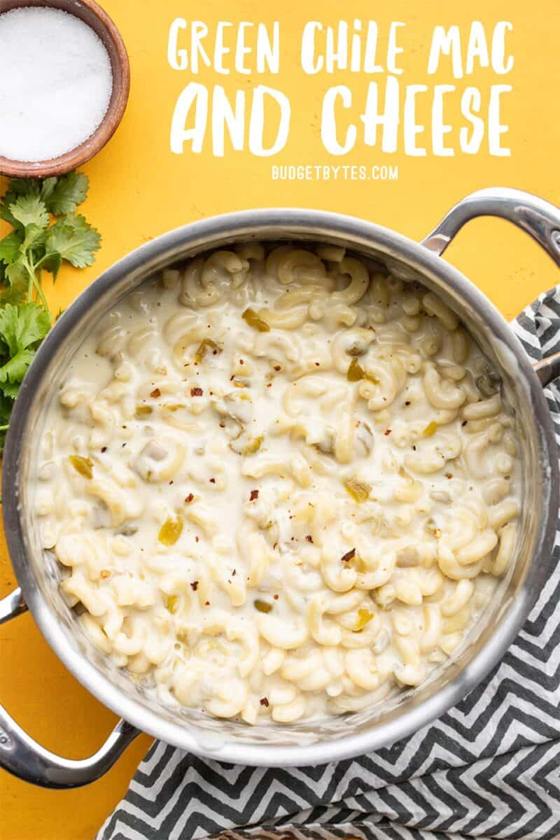 A pot full of green chile mac and cheese, title text at the top