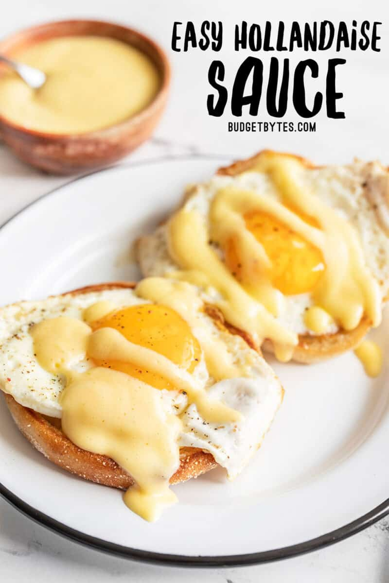 Two eggs on English muffins drizzled with hollandaise sauce, title text at the top