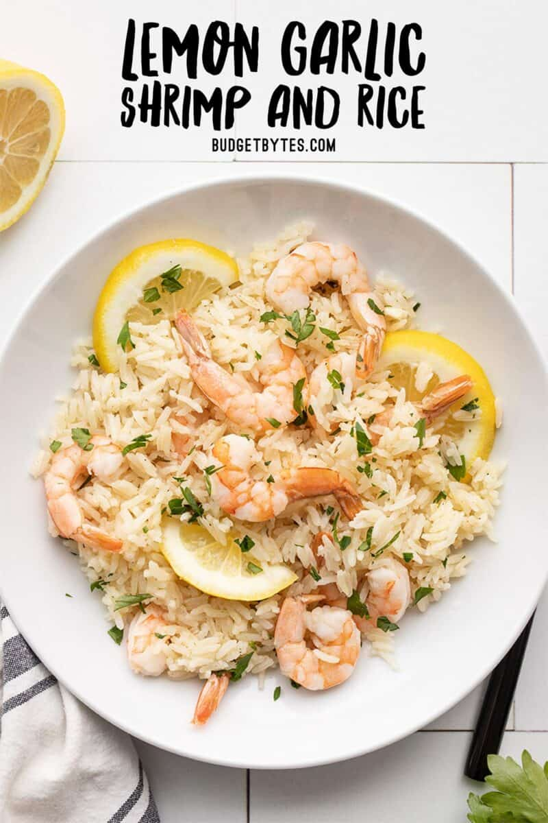 shrimp and rice in a serving bowl with title text at the top
