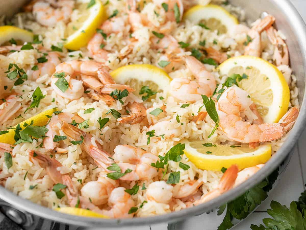 close up side view of lemon garlic shrimp and rice in the skillet