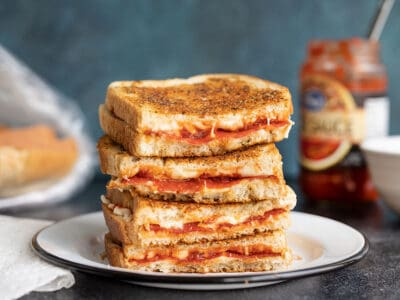A stack of pizza melts, cut sides facing camera